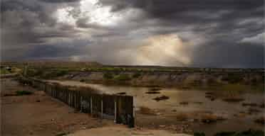A stormy sky over the US-Mexico border. Photograph: Carlos Cazalis