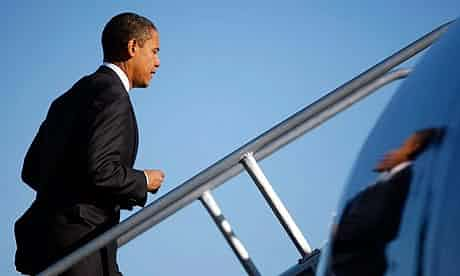 Barack Obama boards his plane at Orlando International airport. Photograph: Joe Raedle/Getty images