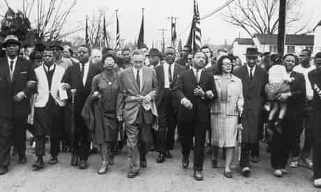 Martin Luther King and his wife Coretta Scott King lead a black voting rights march from Selma, Alabama, to the state capital in Montgomery, a few weeks after Selma