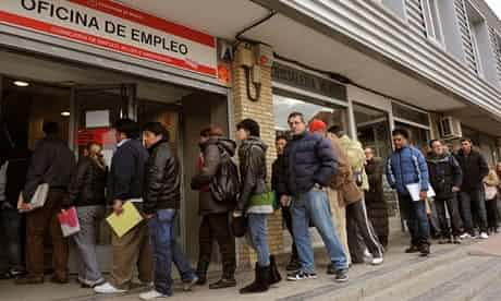 Jobseekers in Madrid this month waiting for an employment centre to open. Photograph: Denis Doyle/Bloomberg via Getty Images