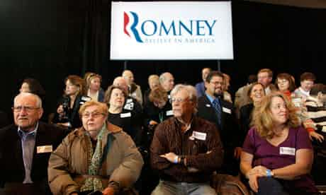 Supporters Mitt Romney wait at his Michigan primary night rally in Novi. Photograph: Mark Blinch/Reuters