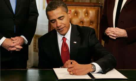 Brave New World? … Barack Obama signs his first act as president in the US Capitol building on 20 January 2009. Photograph: Molly Riley/AP/PA Photos
