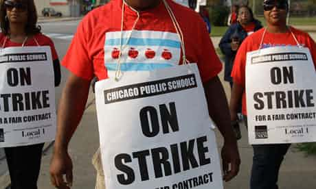 Smaller groups of teachers picket outside Morgan Park high school in Chicago on Monday as the strike heads into its second week. Photograph: M Spencer Green/AP