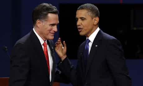 Mitt Romney and President Barack Obama talks after the first presidential debate at the University of Denver. Photograph: Charlie Neibergall/AP