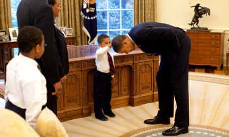 Obama bends over as Jacob Philadelphia touches his hair during a visit to the Oval Office in 2009. Photograph: Pete Souza/The White House