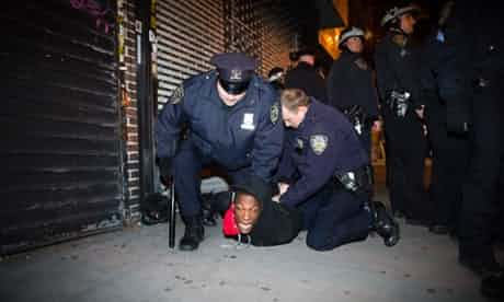 Police officers arrest a demonstrator after a vigil held for Kimani Gray, the teenager shot dead by police officers, after allegedly threatening them with a gun, in the East Flatbush neighborhood of Brooklyn. Photograph: John Minchillo/AP