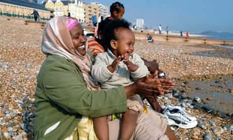 An Oromo family visit the seaside in Brighton, having come to the UK as refugees from Ethiopia under the UK Government Gateway Protection Programme. Photograph: Howard Davies