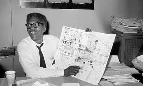 Bayard Rustin points to a map showing the path of the March on Washington during a news conference at the New York City headquarters in August 1963. Photo: AP