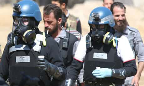 UN chemical weapons experts carry samples from one of the sites of an alleged chemical weapons attack in Damascus on August 28, 2013. Photograph: Stringer/REUTERS