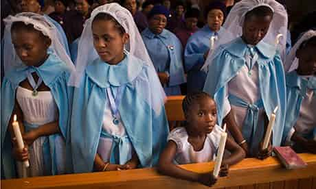 Young members of the choir attend a morning mass in memory of Mandela at the Regina Mundi church. Photograph: Ben Curtis/AP