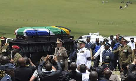 The funeral procession leaving for the grave site following Nelson Mandela