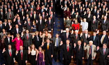 Members of the 113th Congress, many with family members, take the oath of office in the House of Representatives chamber. Photograph: J. Scott Applewhite/AP