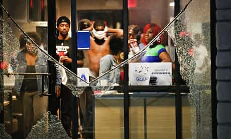 Protesters take cover in a McDonalds with smashed windows. 'People have a right to resist occupation, even if we don't agree with every method.' Scott Olson/Getty Images