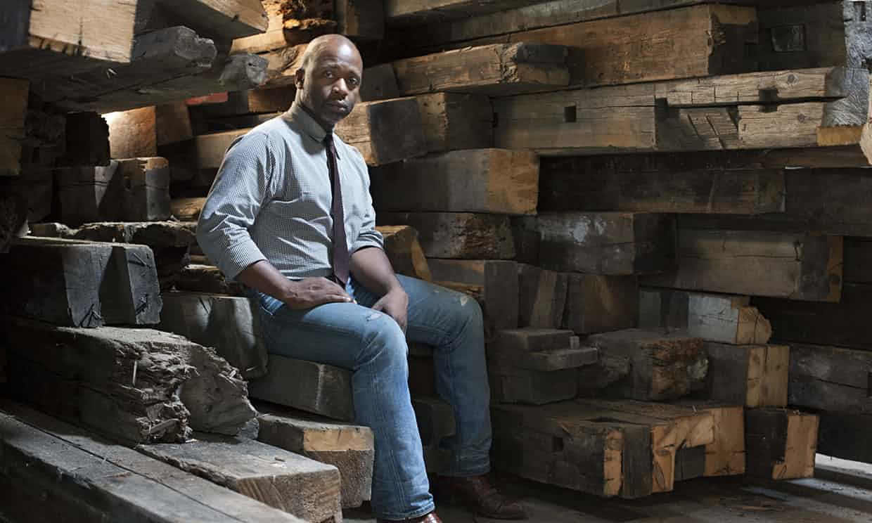 Theaster Gates surrounded by some of the reclaimed raw material of his trade. Photograph: Sara Pooley
