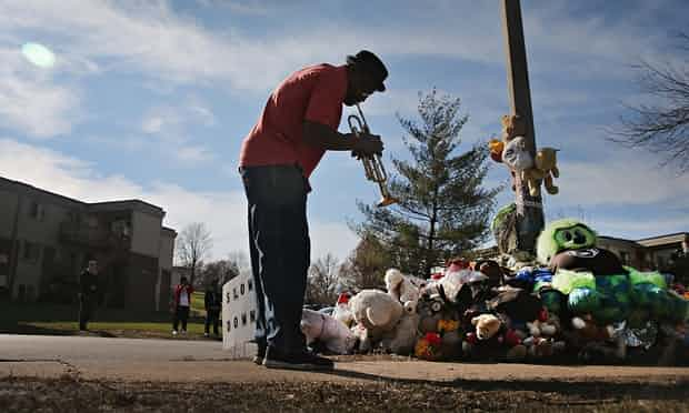 A trumpeter pays his respects at a memorial to Michael Brown in Ferguson, Missouri. Photograph: Scott Olson/Getty Images