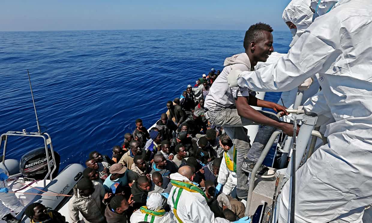 'Many people need to come here precisely because we insisted on going there.' Migrants are rescued in the Mediterranean by Italy's Guardia di Finanza. Photograph: Alessandro Di Meo/EPA