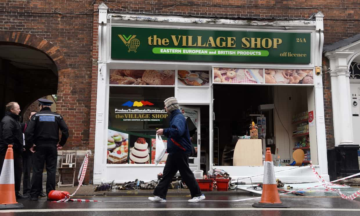 Attacked … The Village Shop in Norwich, an east European food store, was badly damaged in an arson attack in August. Photograph: Steve Adams