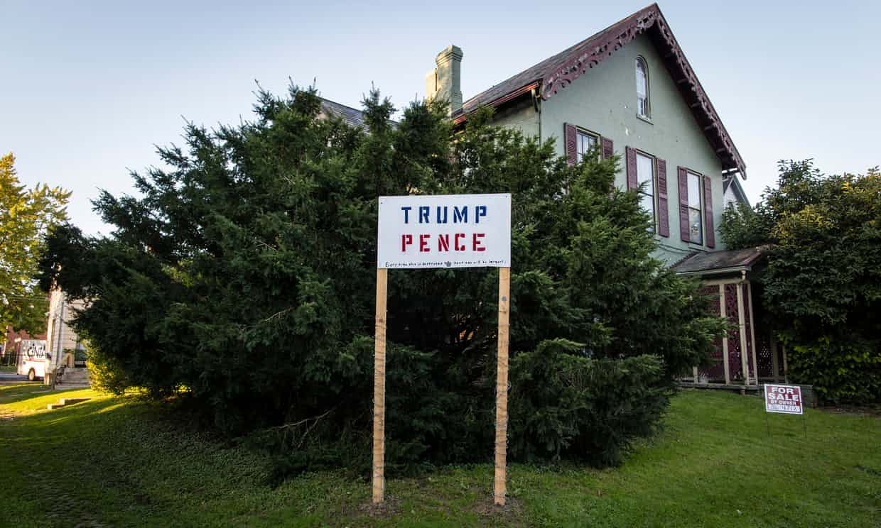 A Trump and Pence election sign outside a house near downtown Muncie Photograph: David Levene for the Guardian