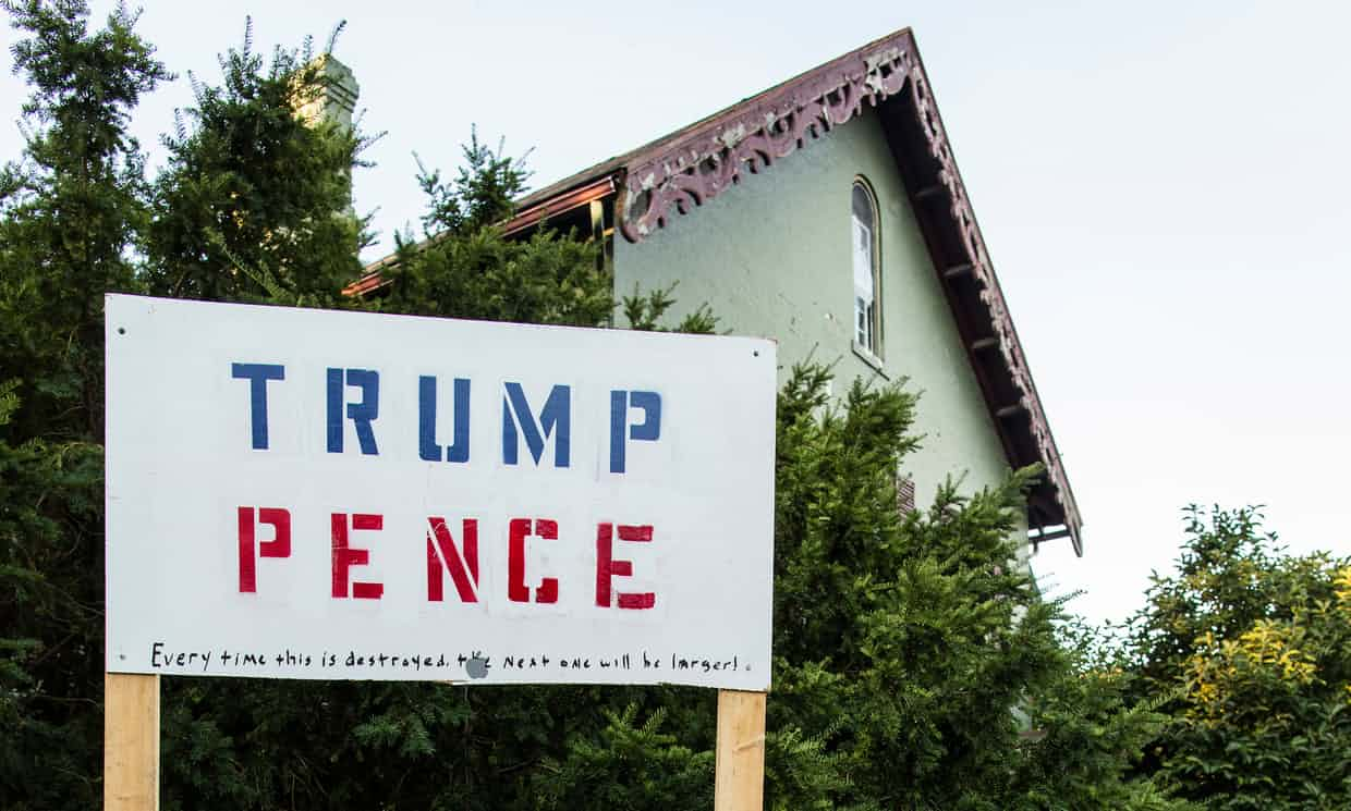 A Trump, Pence sign outside a house near downtown Muncie, Indiana Photograph: David Levene for the Guardian