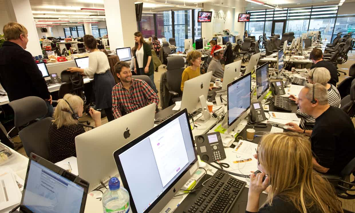 Guardian staff hit the phones. Photograph: Sophia Evans for the Guardian
