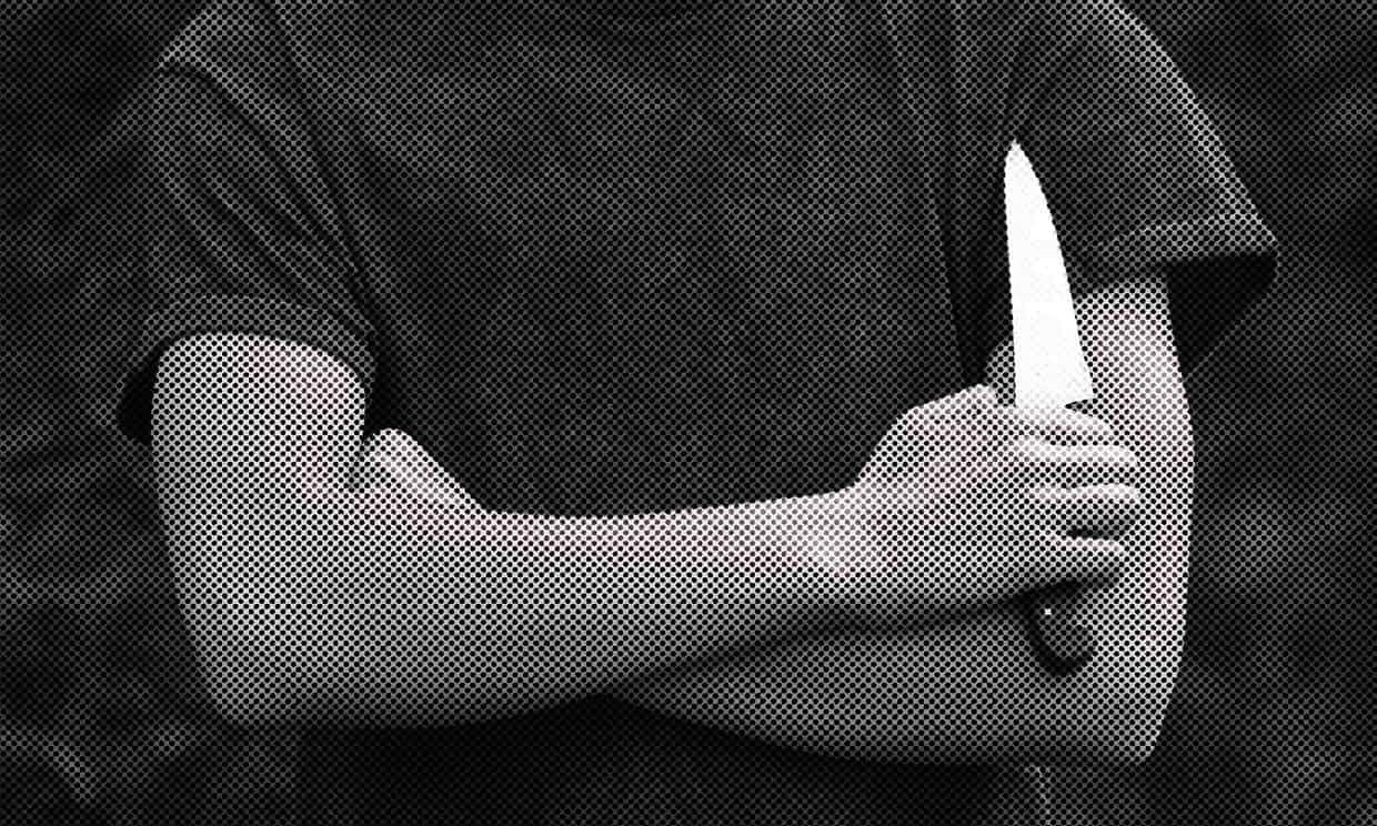 A youth brandishing a knife in the street Photograph: Alamy Stock Photo
