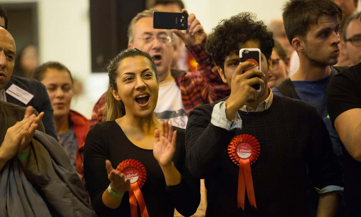 Labour supporters at the Harrow count on election night. Photograph: Graeme Robertson for the Guardian