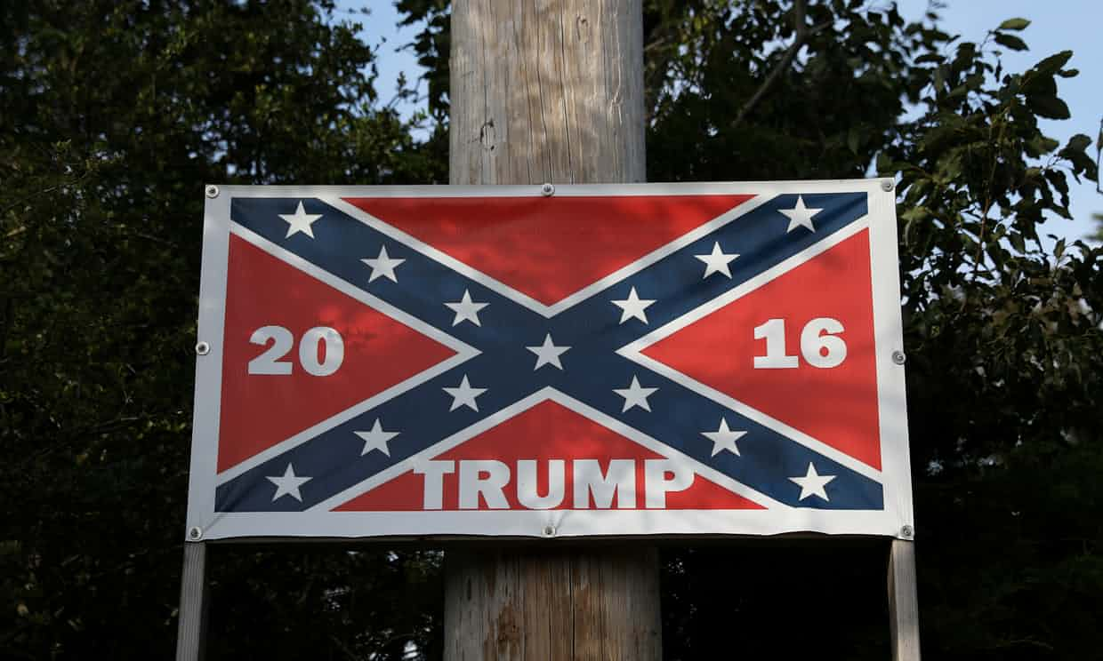 'There's not many white Americans left. They're a dying breed …' a confederate flag on a Trump poster in North Carolina. Photograph: Shannon Stapleton/Reuters