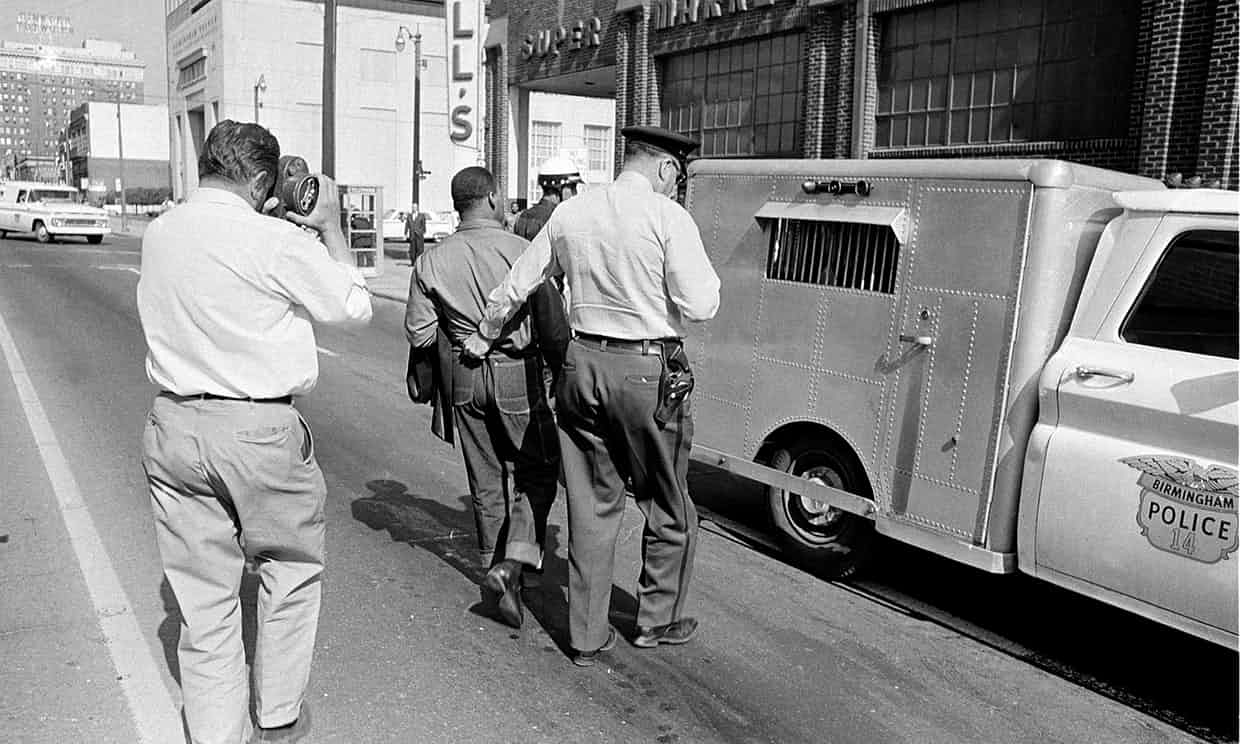 King being arrested in Birmingham, Alabama, in 1963. Photograph: AP