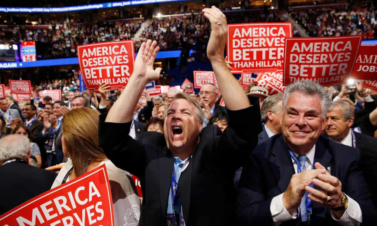 The US representative Peter King of New York and other delegates react as they watch Wisconsin Governor Scott Walker speak during the 2016 Republican National Convention. Photograph: Michael Reynolds/EPA