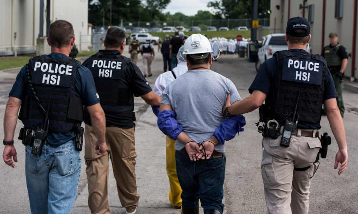 A man is taken away by immigration agents in Ohio. Trump's rhetoric has given license for citizens to vent their bigotry. Photograph: Smith Collection/Gado/Getty Images