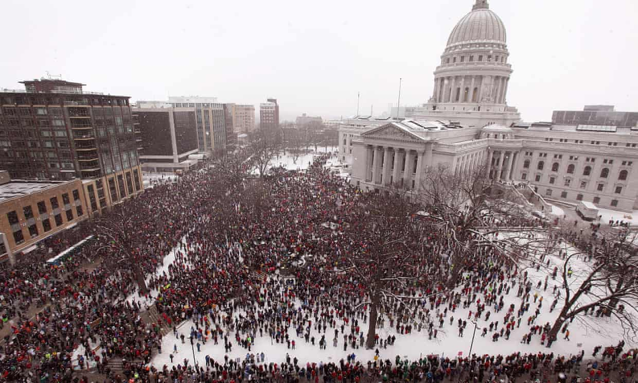 An estimated 70,000 to 100,000 demonstrators rally outside the capitol in Madison, Wisconsin, against restrictions on collective bargaining for government workers in 2011. Photograph: Scott Olson/Getty Images