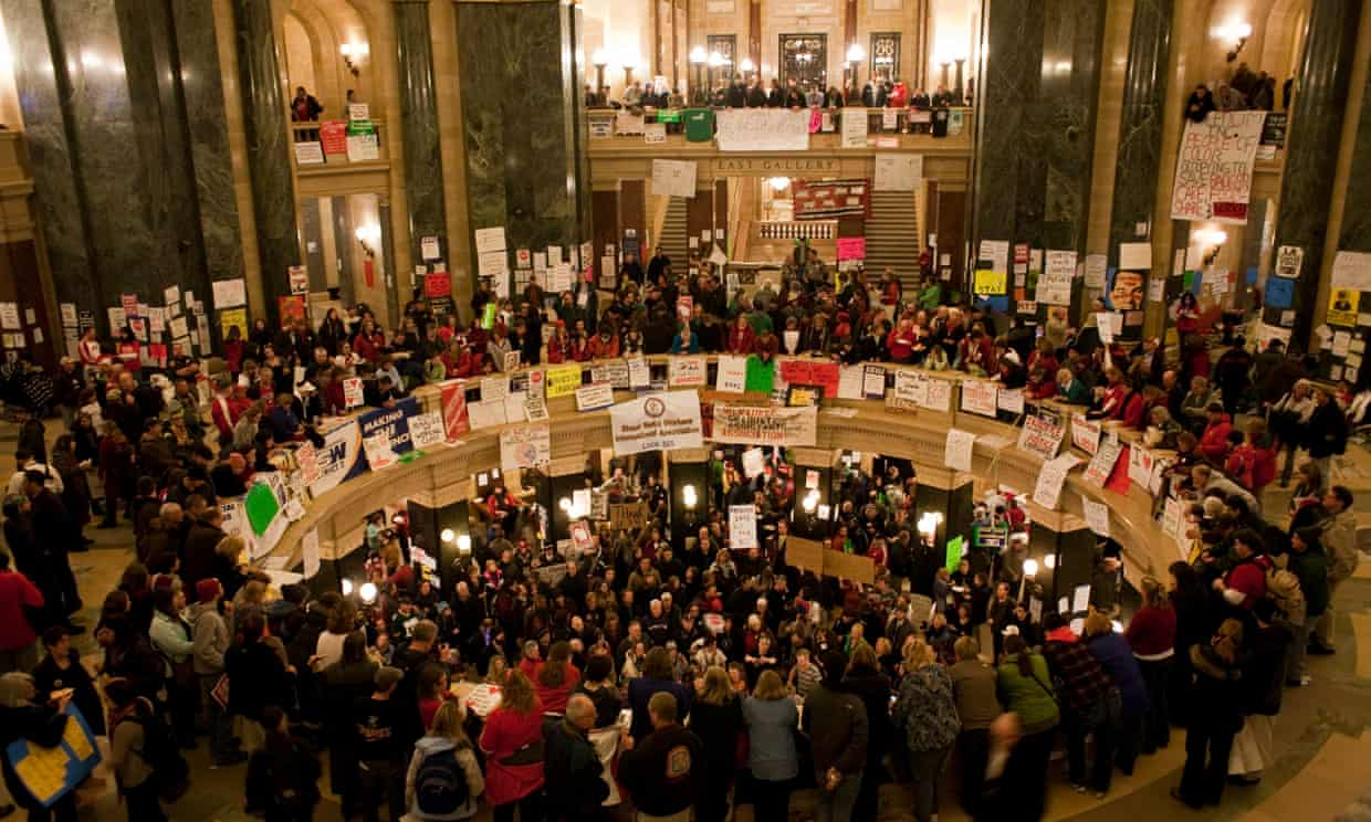 Protesters demonstrate inside the capitol building in Madison in 2011. Photograph: Carlos Ortiz/EPA