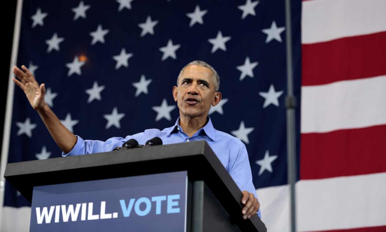 Barack Obama speaks during a campaign rally for Tony Evers and Tammy Baldwin at North Division high school in Milwaukee, Wisconsin, on 26 October. Photograph: Sara Stathas/Reuters