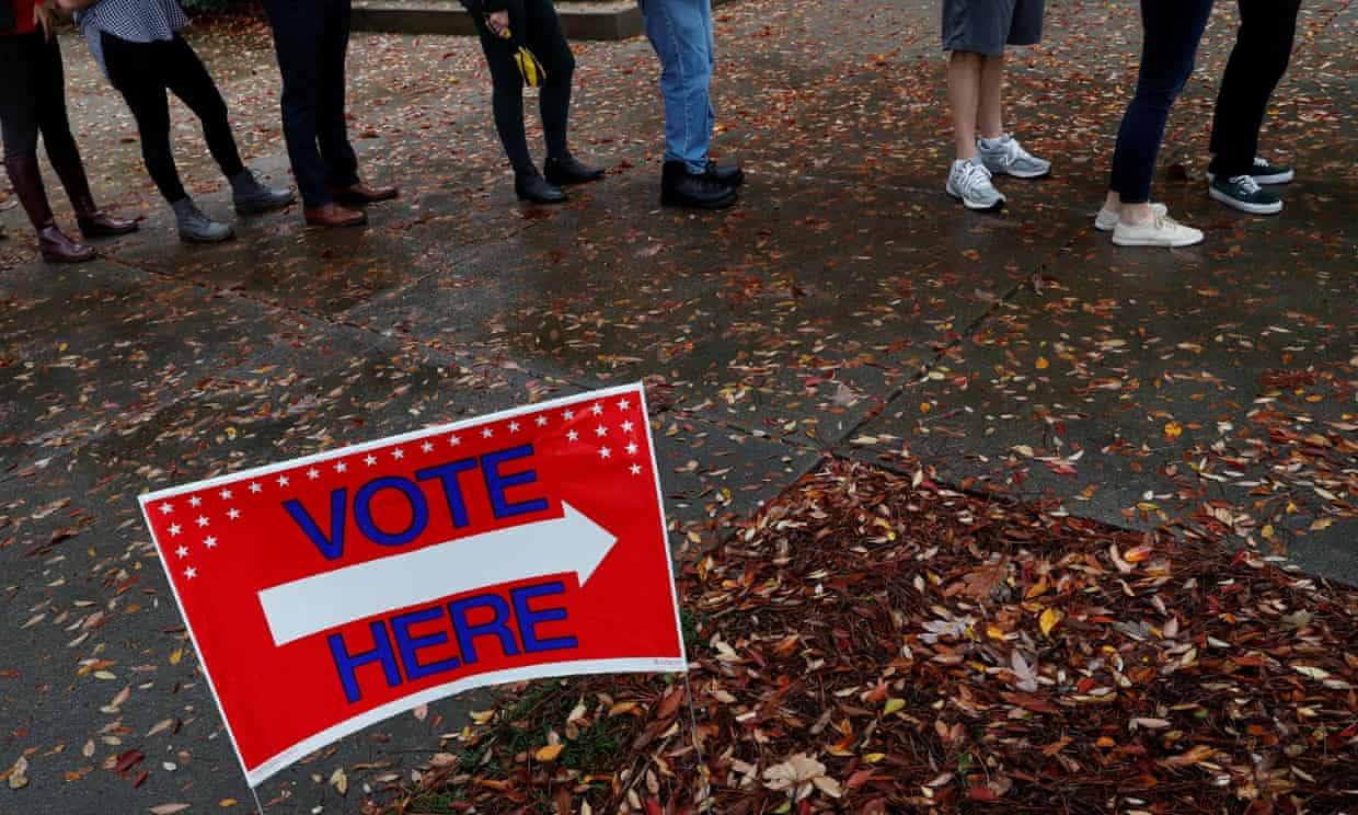 Voters wait in line to cast their votes in the midterm election in Atlanta on Tuesday. Photograph: Leah Millis/Reuters