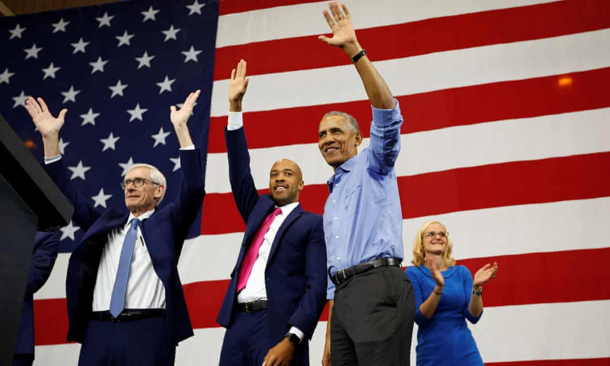 Barack Obama at a campaign rally in Milwaukee, Wisconsin, with governor-elect Tony Evers, Mandela Barnes and Sarah Godlewski on 26 October. Photograph: Sara Stathas/Reuters