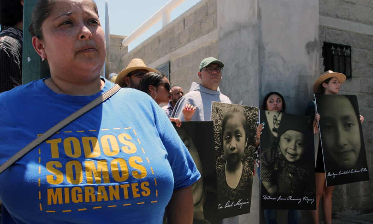 Activists in Ciudad Juarez, Mexico, on Thursday, carrying photographs of migrant children who have died trying to cross the US border with Mexico. Photograph: Hérika Martínez/AFP/Getty Images