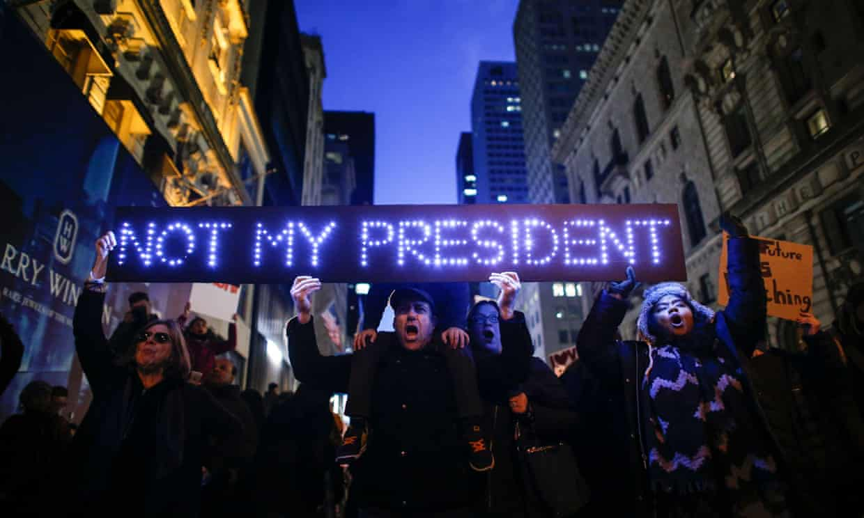 Demonstrators protest against then president-elect Donald Trump in front of Trump Tower in New York City, on 12 November 2016. Photograph: Kena Betancur/AFP/Getty Images