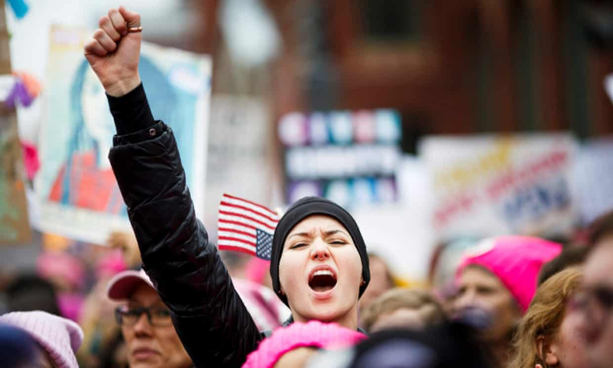 A woman cheers during the Women's March in Washington DC, on 21 January. Photograph: Justin Lane/EPA