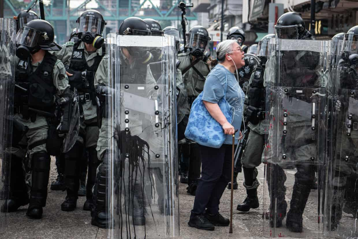A demonstrator and police in Hong Kong this summer. Photograph: Getty Images