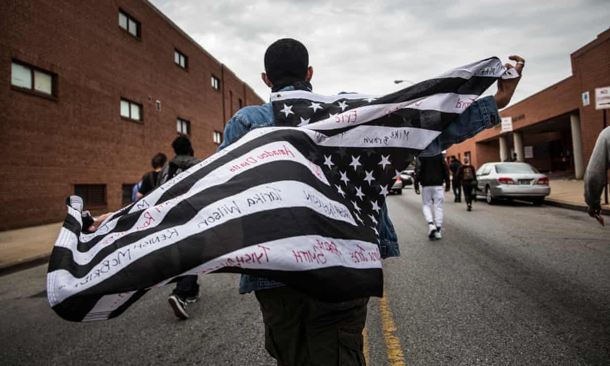 Protesters march through the streets of Baltimore in May 2015, following the death of Freddie Gray in police custody. Photograph: Getty Images