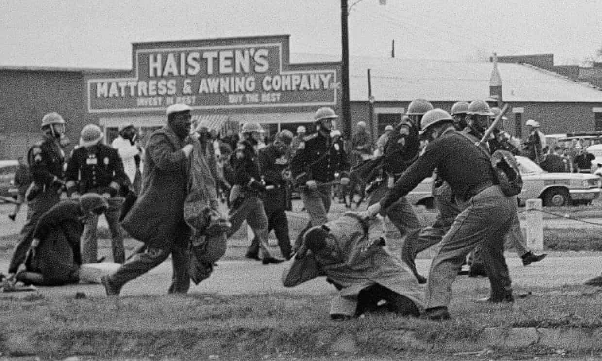 State troopers beat civil rights protesters in Selma, Alabama on 7 March 1965. Photograph: Unknown/AP