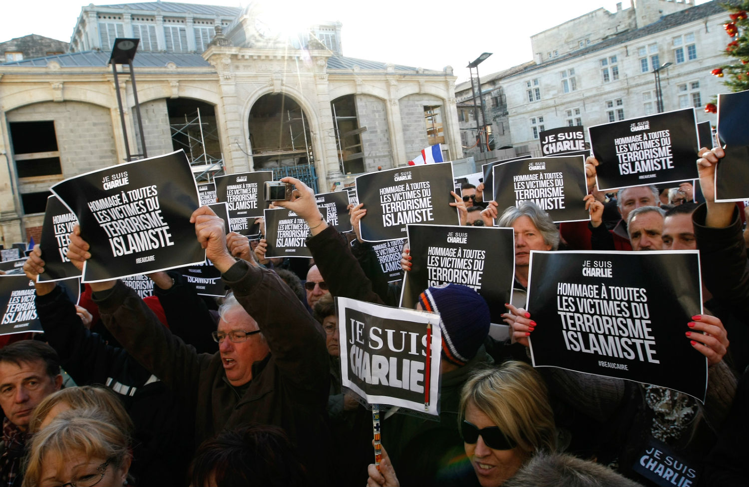 Supporters of Front National leader Marine Le Pen hold placards paying tribute to all the victims of Islamist terrorism during a march on January 11, 2015. (AP Photo/Claude Paris)