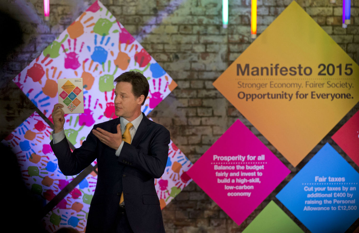 Nick Clegg displays his party manifesto during its launch this week. (AP Photo/Matt Dunham)