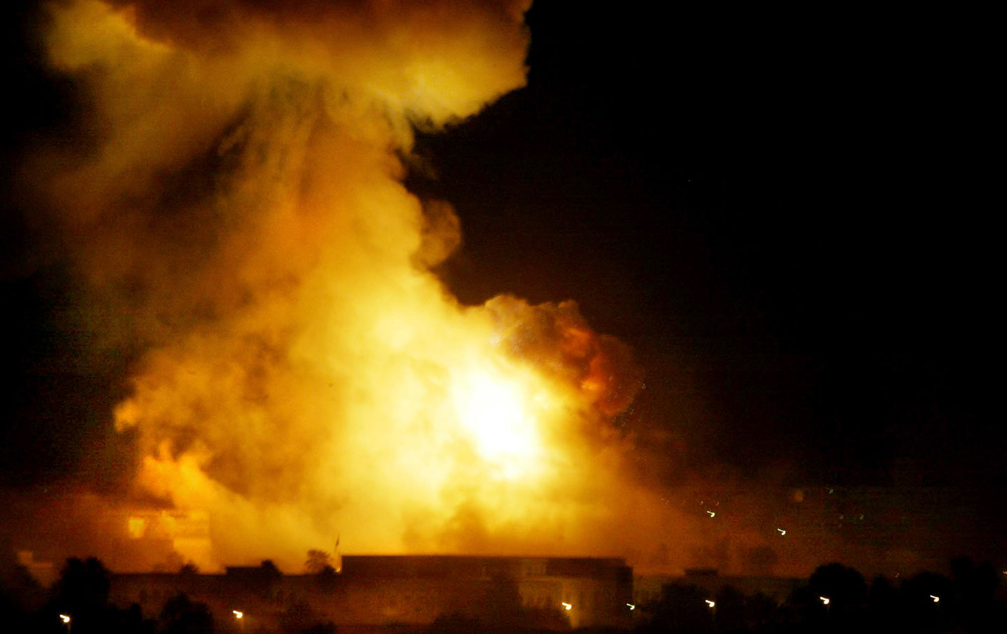 A government building burns during heavy bombardment of Baghdad, Iraq, by US-led forces, March 21, 2003. (AP Photo / Jerome Delay)