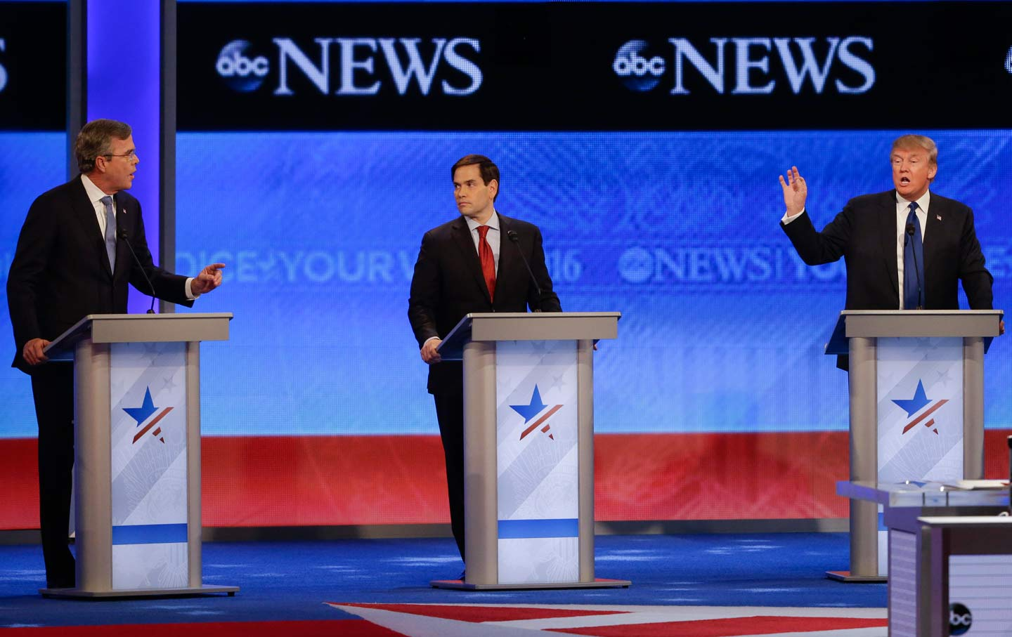 Jeb Bush and Donald Trump spar, as Senator Marco Rubio, R-FL, listens in the middle, during the Republican presidential primary debate at the St. Anselm College Saturday, February 6, 2016, in Manchester, New Hampshire. (AP Photo / David Goldman)