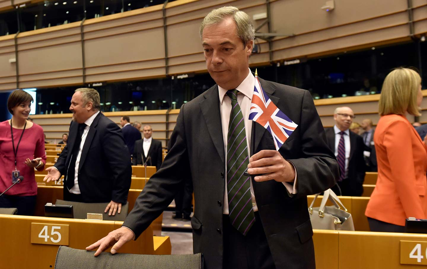 Nigel Farage, the leader of the United Kingdom Independence Party, holds the British flag as he attends a plenary session at the European Parliament on the outcome of the Brexit in Brussels, Belgium, on June 28, 2016.  (Reuters / Eric Vidal)