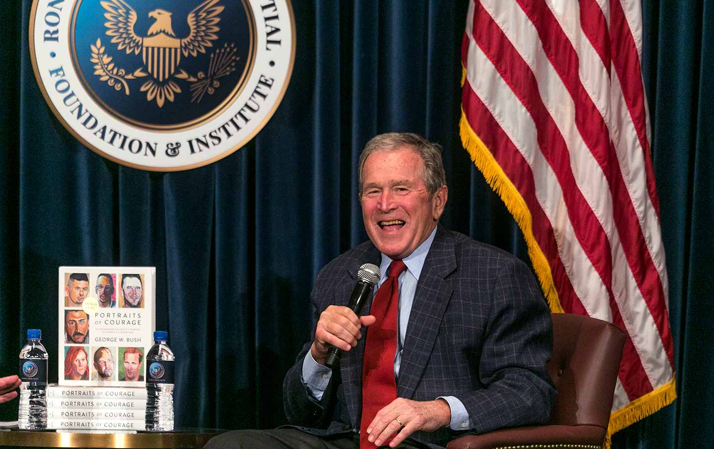 George W. Bush discusses his new book in Simi Valley, California, on March 1, 2017. (AP Photo / Damian Dovarganes)