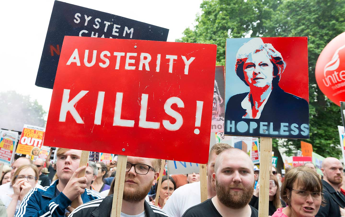 Protesters gathered in London to rally for an end to austerity in July 2017.  (Ik Aldama / picture-alliance / dpa/ AP Images)