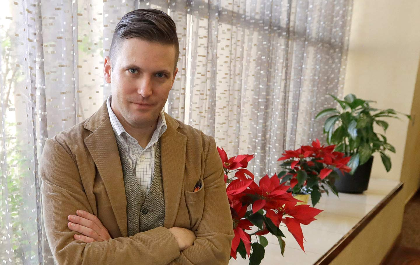 White nationalist Richard Spencer poses between interviews in College Station, Texas, on December 6, 2016. (AP Photo / David J. Phillip)