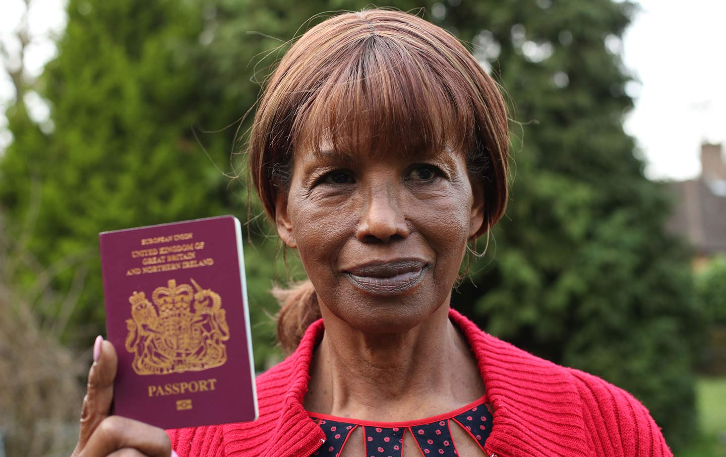 Ruth Williams, 75, who came to the UK as part of the Windrush generation, with her British passport, April 17, 2018.  (AP Images)